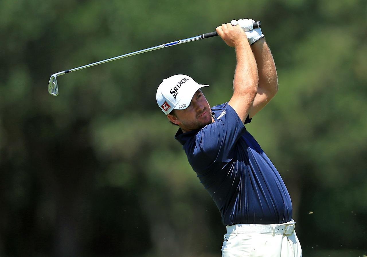 PONTE VEDRA BEACH, FL - MAY 10:  Graeme McDowell of Northern Ireland plays his second shot at the par 4, 14th hole during the first round of THE PLAYERS Championship held at THE PLAYERS Stadium course at TPC Sawgrass on May 10, 2012 in Ponte Vedra Beach, Florida.  (Photo by David Cannon/Getty Images)