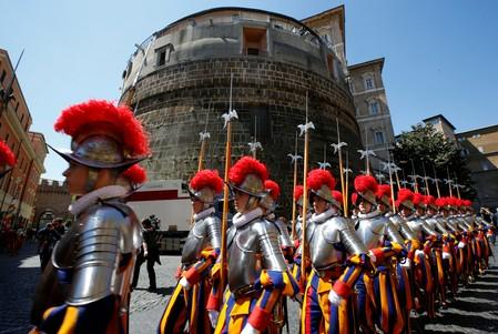 FILE PHOTO: New recruits of the Vatican's elite Swiss Guard march in front of the tower of the Institute for Works of Religion during the swearing-in ceremony at the Vatican