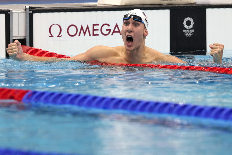 Chase Kalisz, of the United States, celebrates winning the final of the men's 400-meter individual medley at the 2020 Summer Olympics, Sunday, July 25, 2021, in Tokyo, Japan. (AP Photo/Martin Meissner)