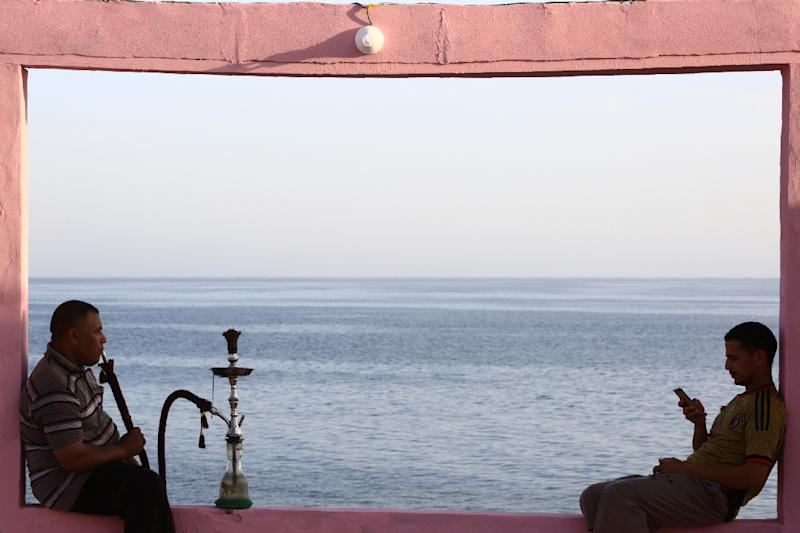 A massive Saudi tourism project will cover more than 180 kilometres of coastline stretching from Umm Lajj to Al-Wajh, where two men are seen here at a cafe overlooking the Red Sea