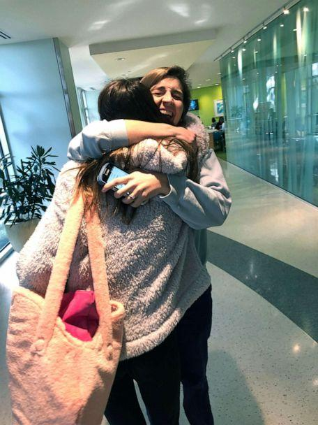 PHOTO: Bella Pacini hugging her child life specialist upon entering the hospital for her liver transplant. (Courtesy Tracy Pacini)