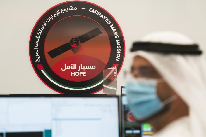 An Emirati scientist prepares for the launch of the Emirates' Hope space probe to Mars at the Mohammed bin Rashid Space Centre in Dubai, United Arab Emirates, Sunday, July 19, 2020. A Japanese H-IIA rocket carrying a United Arab Emirates Mars spacecraft has been placed on the launch pad for Monday's scheduled liftoff for the Arab world's first interplanetary mission, officials said Sunday. (AP Photo/Jon Gambrell)