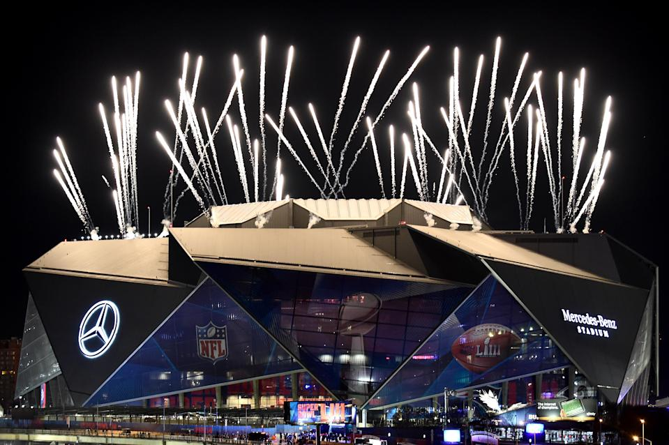 <p>Fireworks shoot in the air above Mercedes-Benz stadium during halftime of Super Bowl LIII between the New England Patriots and Los Angeles Rams on February 03, 2019 in Atlanta, Georgia. (Photo by Logan Riely/Getty Images) </p>