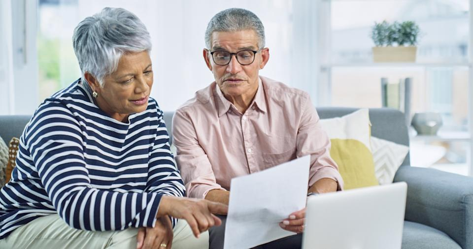 Shot of a senior couple going over their finances at home