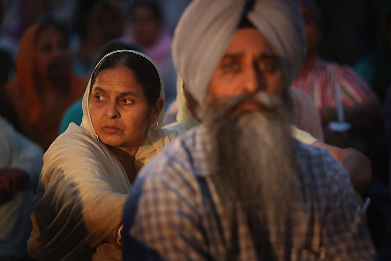 Members of the Sikh Temple of Wisconsin attend a vigil to mark the one-year anniversary of the shooting at the temple August 5, 2013 in Oak Creek, Wisconsin (AFP Photo/Scott Olson)