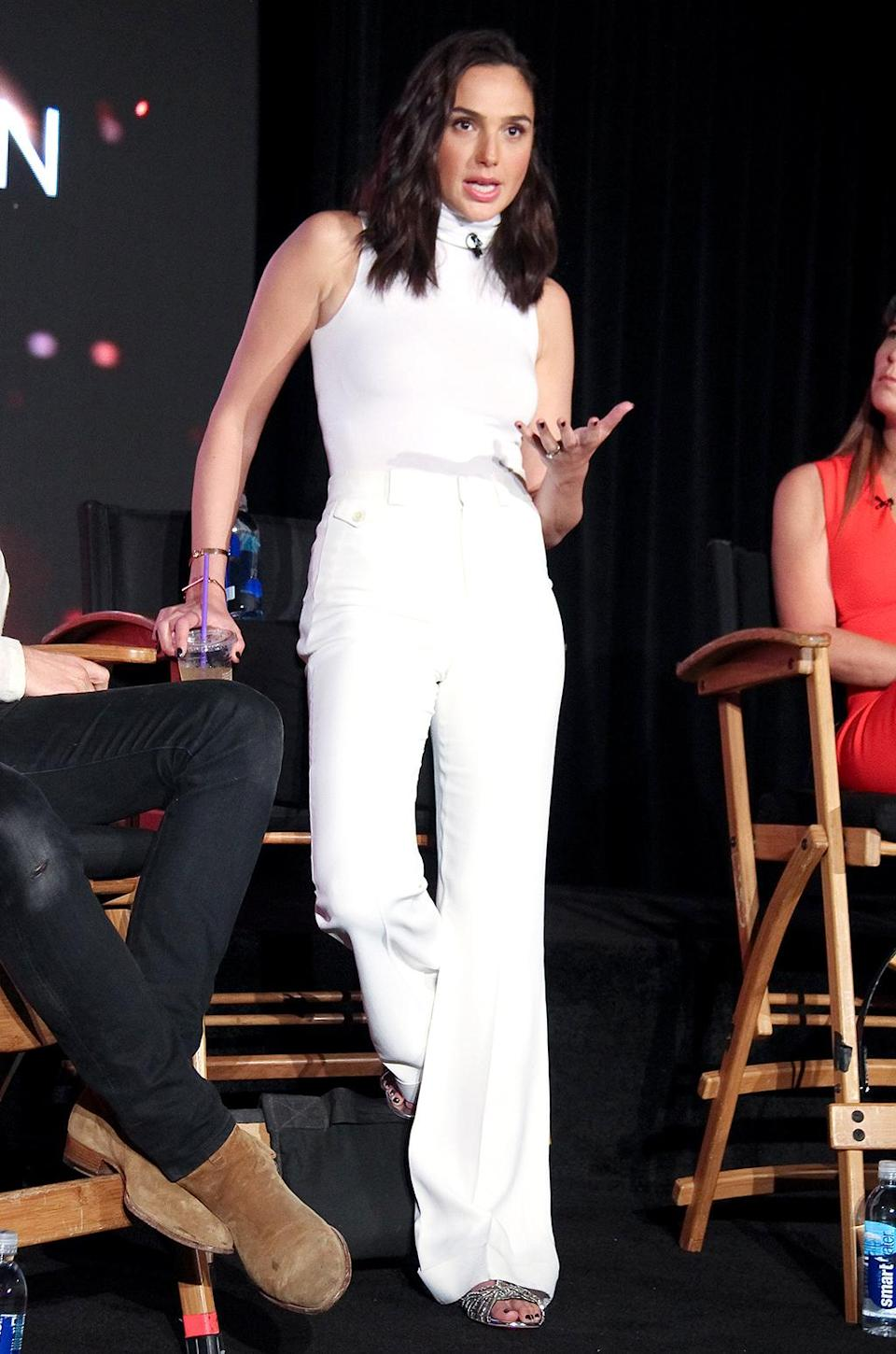 <p>Gadot donned wide-leg pants and a sleeveless turtleneck for a press conference in Culver City, Calif. Although there was no cape, the outfit still read strong all over. (Photo: PictureLux/Splash News) </p>