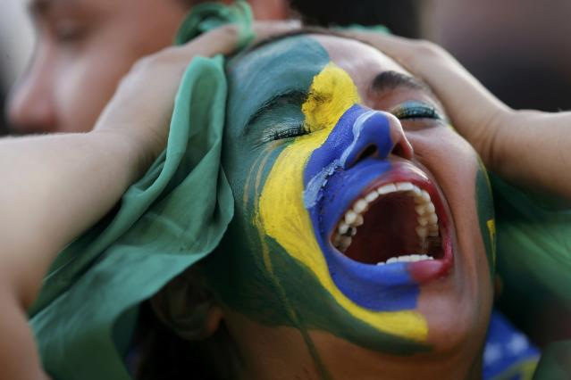 Fans of Brazil react while watching a broadcast of the 2014 World Cup semi-final against Germany at the Fan Fest in Brasilia, July 8, 2014. REUTERS/Ueslei Marcelino (BRAZIL - Tags: SOCCER SPORT WORLD CUP TPX IMAGES OF THE DAY)