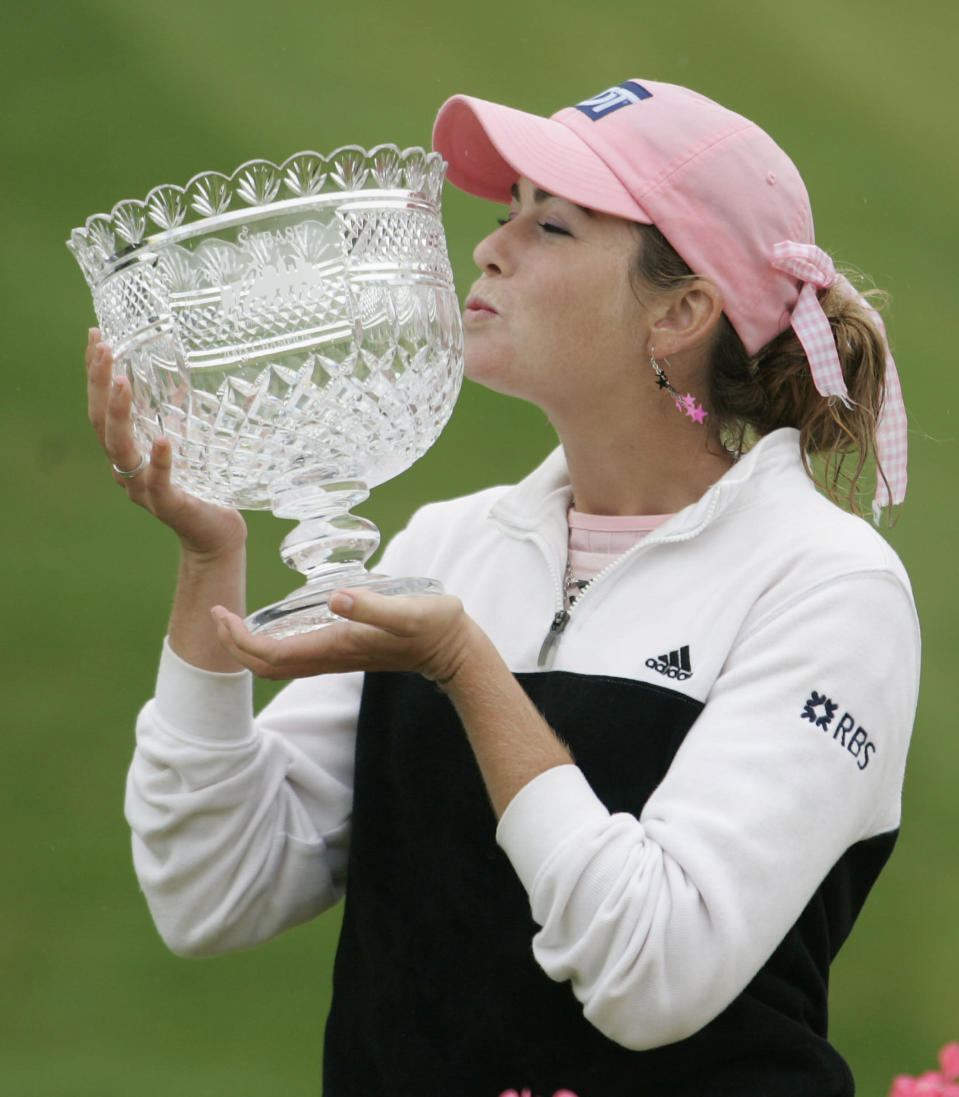 FILE - In this May 22, 2005, file photo, Paula Creamer kisses the trophy after winning the LPGA Sybase Classic in New Rochelle, N.Y. It was 15 years ago this week that Creamer won her first pro title, five days before her high school graduation. (AP Photo/Ed Betz, File)