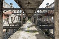 <p>Except for some paperwork, most of the building was burned. You can still see the black covered bricks on the facade of the building. Abkhazia has a long history of war and battling for freedom since its origins in 756 AD. (Photo: Bob Thissen/Caters News) </p>