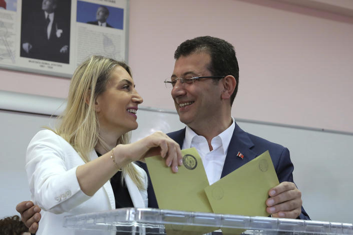 Ekrem Imamoglu, mayoral candidate for Istanbul of Republican People's Party CHPV, and his wife Dilek cast their ballot at a polling station during the local elections in Istanbul, Sunday, March 31, 2019. Turkish citizens have begun casting votes in municipal elections for mayors, local assembly representatives and neighborhood or village administrators that are seen as a barometer of Erdogan's popularity amid a sharp economic downturn. (AP Photo)