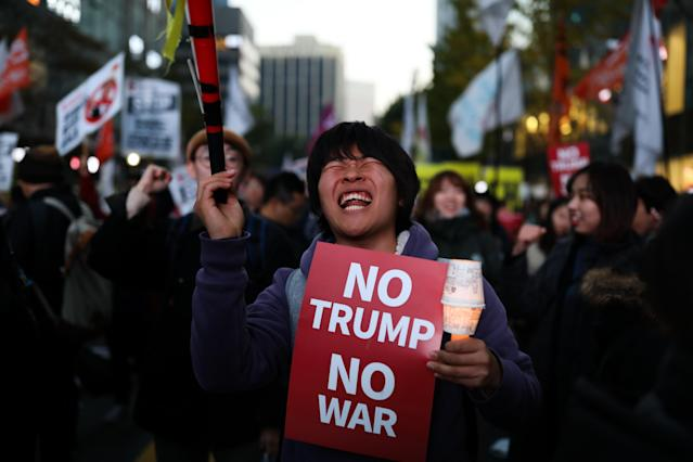 <p>A demonstrator holds a placard reading 'No Trump No War' during a protest ahead of President Donald Trump's visit near the U.S. Embassy in Seoul, South Korea, on Saturday, Nov. 4, 2017. (Photo: Seong Joon Cho/Bloomberg via Getty Images) </p>