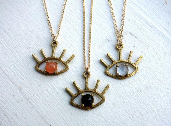 """<a href=""""https://www.etsy.com/listing/457630874/the-beholder-brass-and-onyx-moonstone?ref=finds_l"""" target=""""_blank"""">Get it here</a>."""