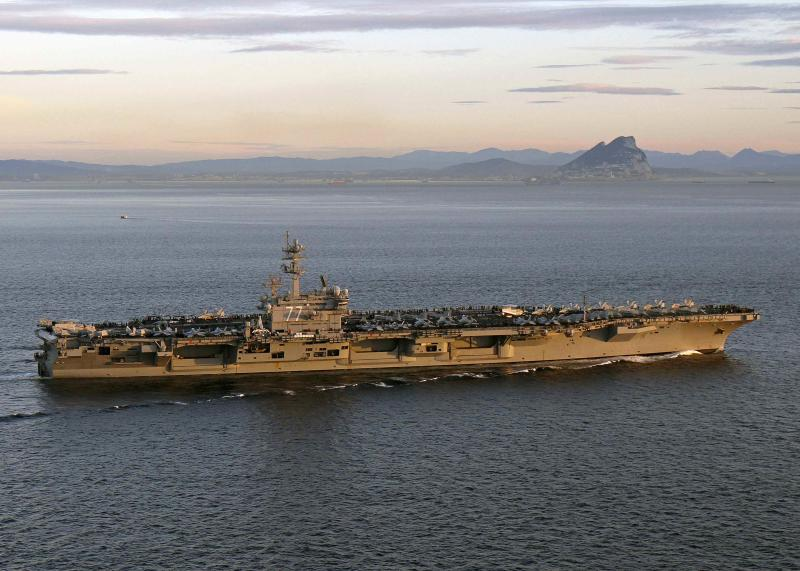 Handout photo of aircraft carrier USS George H.W. Bush transiting the Strait of Gibraltar into the Mediterranean Sea