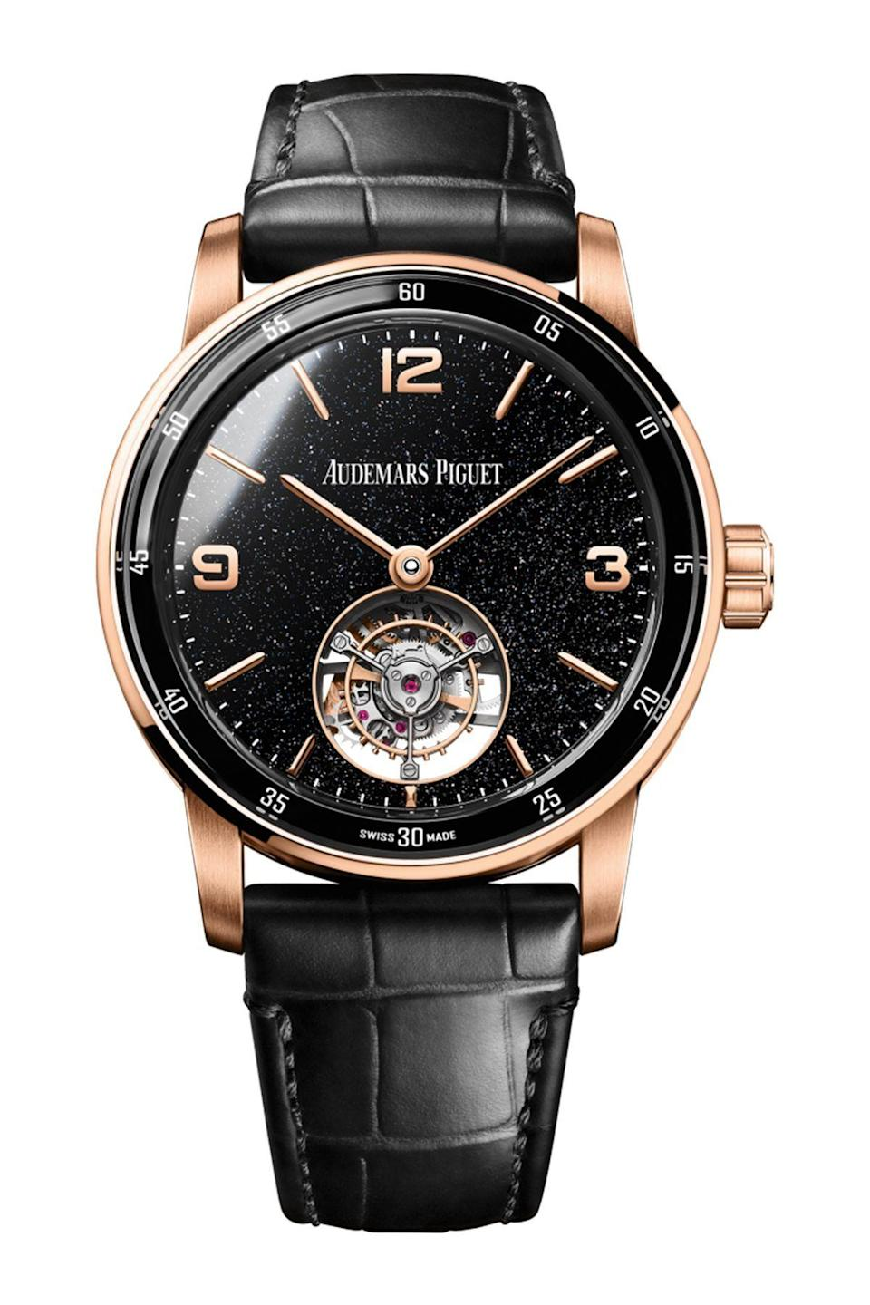 """<p><strong>Audemars Piguet</strong></p><p>audemarspiguet.com</p><p><a href=""""https://www.audemarspiguet.com/com/en/watch-collection/code-1159/26396OR.OO.D002CR.02.html"""" rel=""""nofollow noopener"""" target=""""_blank"""" data-ylk=""""slk:Shop Now"""" class=""""link rapid-noclick-resp"""">Shop Now</a></p><p>For more of a statement, the black band and watch face are elevated by the softness of the rose gold details of this timepiece. </p>"""