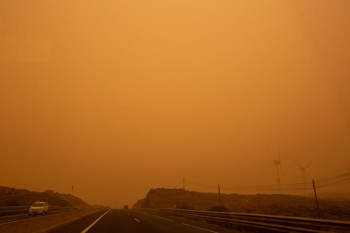 Cars drive on the TF-1 highway during a sandstorm in Santa Cruz de Tenerife, on the Canary Island of Tenerife, on February 23, 2020.