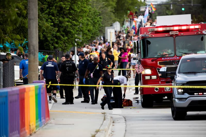 Police and firefighters respond after a truck drove into a crowd of people during The Stonewall Pride Parade and Street Festival in Wilton Manors