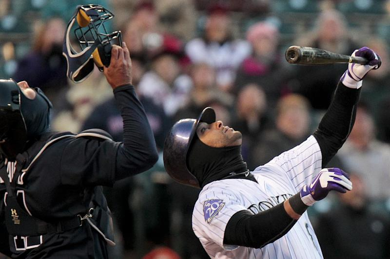 File-This April 23, 2013 file photo shows Colorado Rockies' Yorvit Torrealba, right, popping up to Atlanta Braves catcher Gerald Laird, left, who made the out during the second inning of the second game of a doubleheader in Denver. When the Atlanta Braves and Colorado Rockies started up at Coors Field in late April, it was 23 degrees. That made it the coldest game time temperature since STATS began recording them more than two decades ago. (AP Photo/Barry Gutierrez)