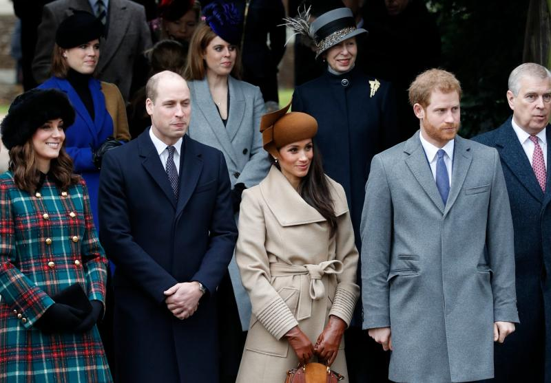 A photo of Britain's Catherine, Duchess of Cambridge, (L) and Britain's Prince William, Duke of Cambridge, (2L), US actress and fiancee of Britain's Prince Harry Meghan Markle (2R) and Britain's Prince Harry (R) stand together as they wait to see off Britain's Queen Elizabeth II after attending the Royal Family's traditional Christmas Day church service at St Mary Magdalene Church in Sandringham, Norfolk, eastern England, on December 25, 2017.
