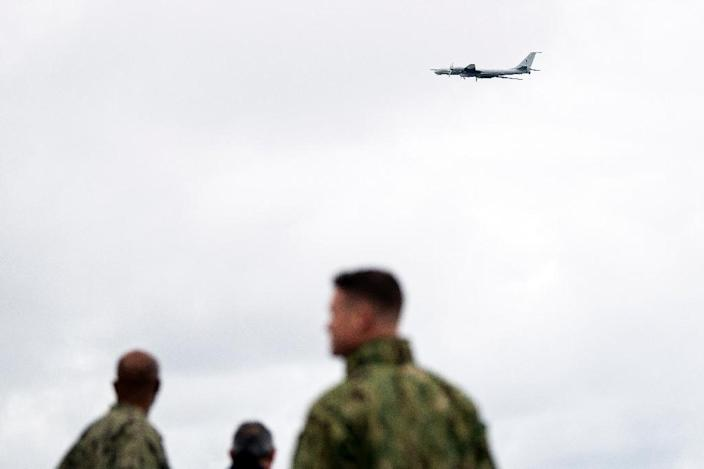 NATO forces on the USS Moutn Whitnes watch a Russian Tupolev TU-142 fly past (AFP Photo/Jonathan NACKSTRAND)
