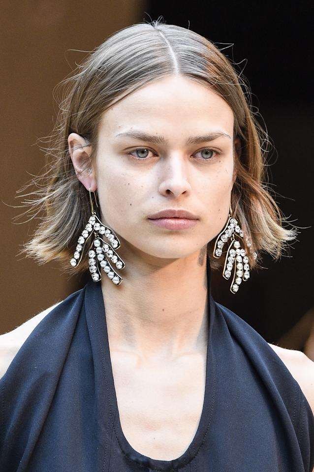 <p>At the Celine Fall/Winter 2017 show, models wore their hair in sleek, natural waves that looked as if they were air-dried–to perfection.</p>