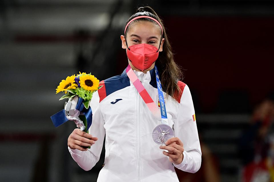 Spain's Adriana Cerezo Iglesias celebrates with her silver medal on the podium after winning the taekwondo women's -49kg gold medal bout during the Tokyo 2020 Olympic Games at the Makuhari Messe Hall in Tokyo on July 24, 2021. (Photo by Javier SORIANO / AFP) (Photo by JAVIER SORIANO/AFP via Getty Images)