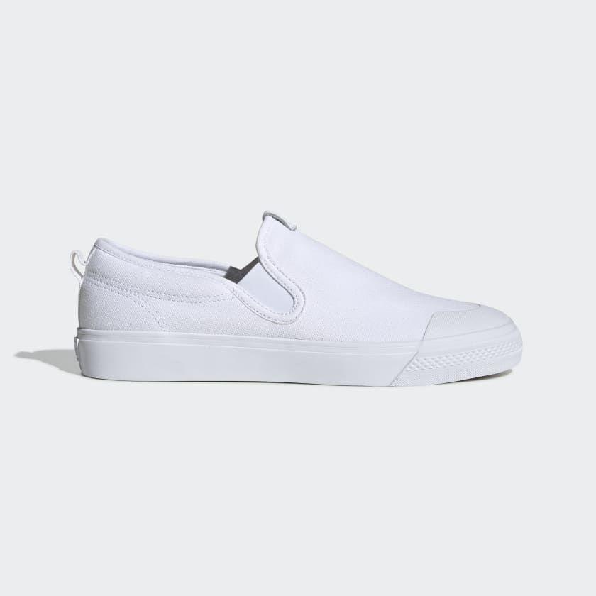 """<p><strong>adidas</strong></p><p>adidas.com</p><p><a href=""""https://go.redirectingat.com?id=74968X1596630&url=https%3A%2F%2Fwww.adidas.com%2Fus%2Fnizza-slip-on-shoes%2FEF1185.html&sref=https%3A%2F%2Fwww.menshealth.com%2Fstyle%2Fg32628591%2Fadidas-memorial-day-sneaker-sale%2F"""" rel=""""nofollow noopener"""" target=""""_blank"""" data-ylk=""""slk:BUY IT HERE"""" class=""""link rapid-noclick-resp"""">BUY IT HERE</a></p><p><del>$60<br></del><strong>$36</strong></p><p>White sneakers are hard to keep clean, and we're not above getting a fresh pair for the season. And at 36 bucks, we might get two. </p>"""