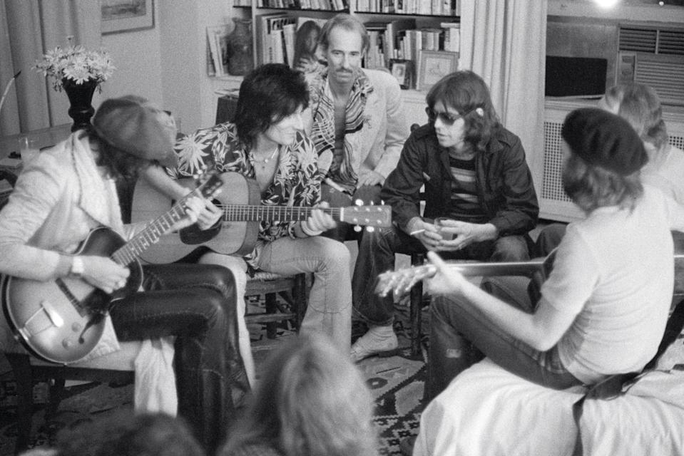 <p>The Rolling Stones jammed out in the McGraths' house after their June 26 concert at Madison Square Garden on their 1975 tour. Keith Richards, Ronnie Wood, John Phillips, and Mick Jagger sat on chairs, while Eric Clapton sat on the bed.</p>