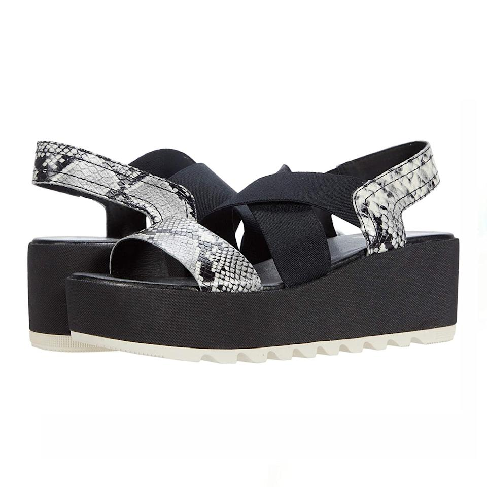 """This Sorel sandal is basically the perfect marriage of comfort and style. Plus, it comes in a variety of colors to match all of your vacation outfits. $125, Zappos. <a href=""""https://www.zappos.com/p/sorel-cameron-flatform-slingback-black/product/9466780/color/3"""" rel=""""nofollow noopener"""" target=""""_blank"""" data-ylk=""""slk:Get it now!"""" class=""""link rapid-noclick-resp"""">Get it now!</a>"""