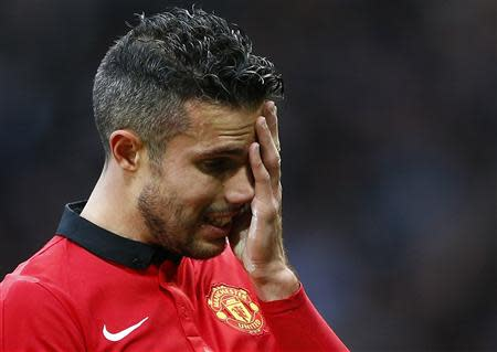 Manchester United's Robin van Persie reacts after losing to Newcastle United in their English Premier League soccer match at Old Trafford in Manchester, northern England, December 7, 2013. REUTERS/Darren Staples