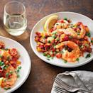 <p>Paella is an iconic Spanish dish made with rice, seasonings and various meats or seafood, depending on the paella type. Our slow-cooker paella recipe features shrimp, brown rice, turmeric, a host of vegetables and Spanish chorizo--not to be confused with Mexican chorizo, which isn't dried or cured like the Spanish variety.</p>