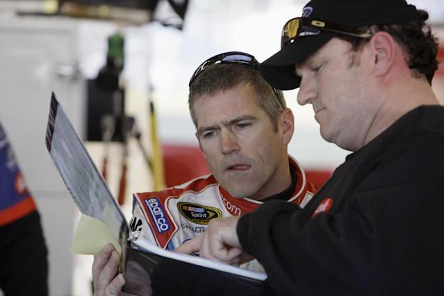 NASCAR driver Bobby Labonte, left, meets with his crew chief Todd Parrott during practice for the Bud Shootout Race at Daytona International Speedway in Daytona Beach, Fla., Friday, Feb. 6, 2009. (AP Photo/John Raoux)