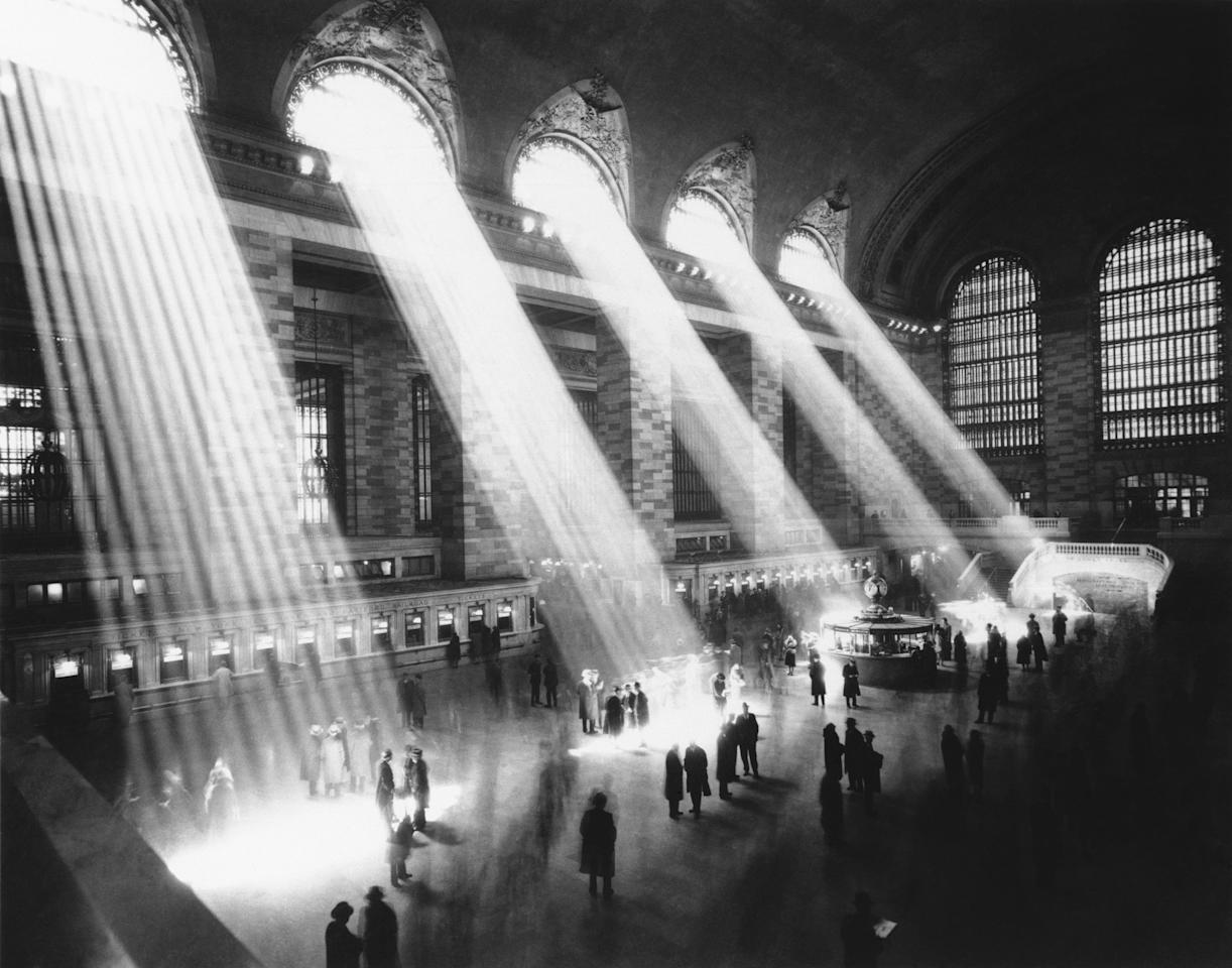 Sunlight steams through the dome windows striking the floor of the main concourse of Grand Central Terminal in 1937.  (AP Photo/Municipal Archives of the City of New York)