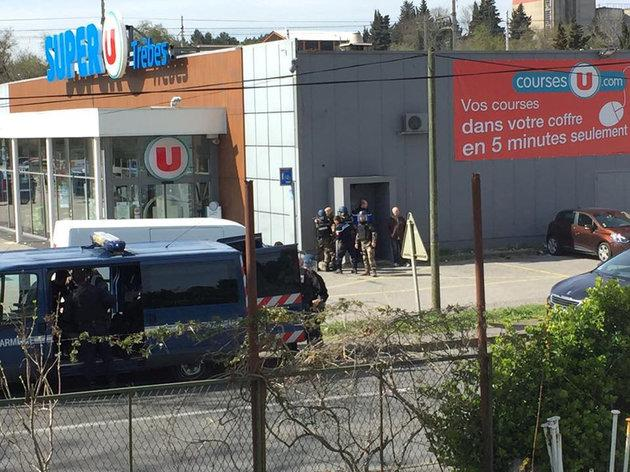 Police are seen at the scene of a hostage situation in a supermarket in Trebes, Aude, France, on Friday morning.