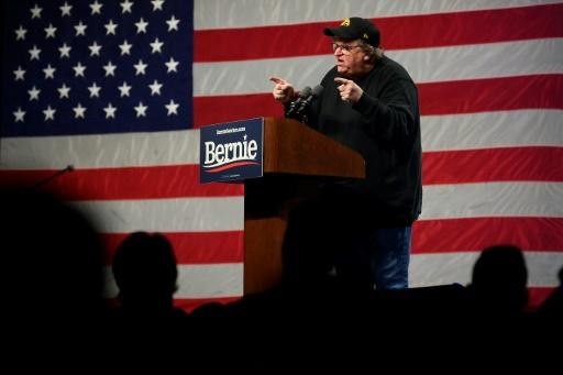 With presidential hopeful Senator Bernie Sanders stuck in Washington for the impeachment trial of President Donald Trump, filmmaker and activist Michael Moore stood in the candidate's place at a campaign event in Clive, Iowa
