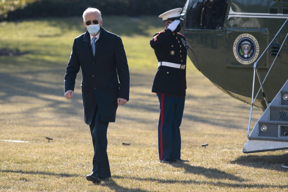 President Joe Biden arrives on the South Lawn of the White House, Monday, Feb. 8, 2021, in Washington. (AP Photo/Evan Vucci)