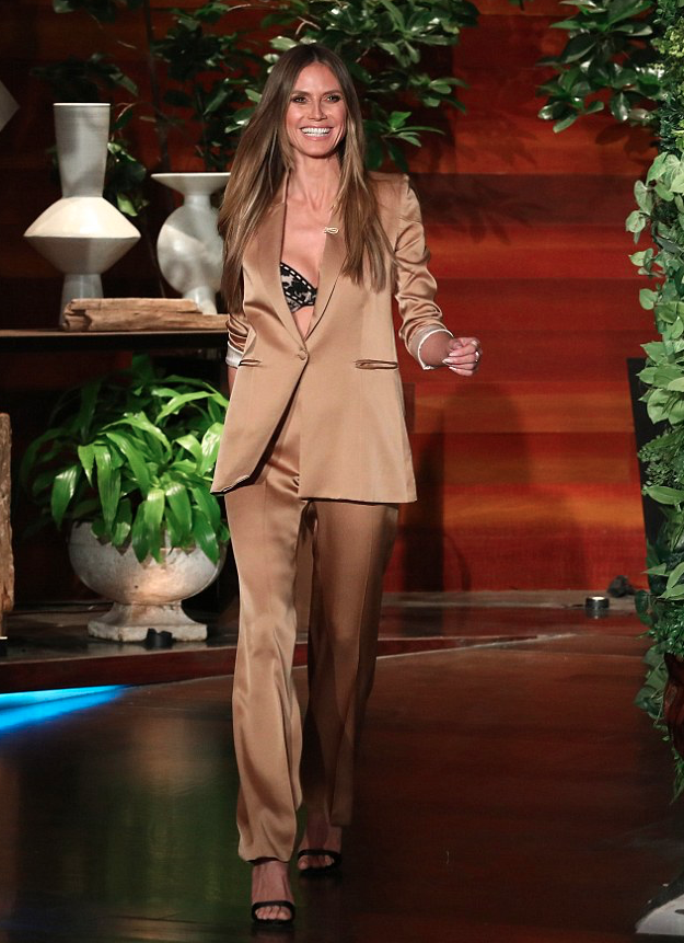 <p>Check out the celebrities that have nailed the latest fashion trend by wearing a sexy bra over a tailored blazer.  Heidi Klum stuns in this rock-chic look.</p>