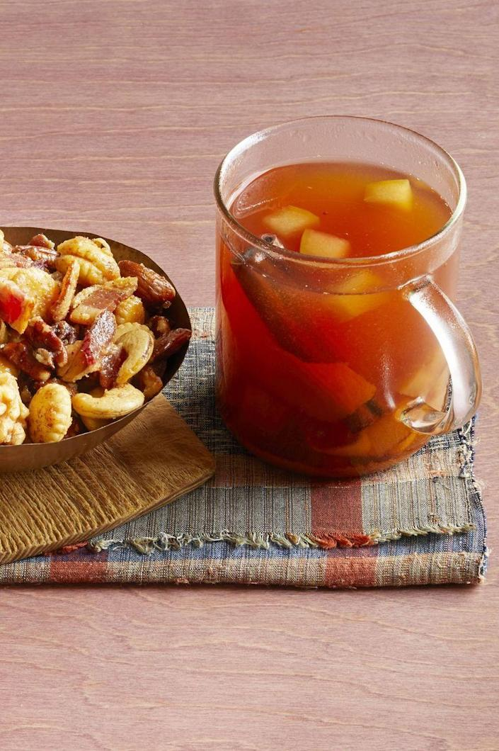 """<p>Not only does this warm cider taste delicious but it will make your whole house smell like delicious spices.</p><p> <strong><a href=""""https://www.thepioneerwoman.com/food-cooking/recipes/a32304617/mulled-cider-with-bourbon-recipe/"""" rel=""""nofollow noopener"""" target=""""_blank"""" data-ylk=""""slk:Get the recipe."""" class=""""link rapid-noclick-resp"""">Get the recipe.</a></strong></p>"""