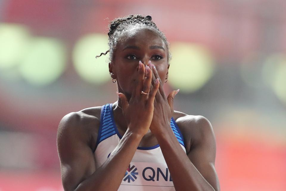 Britain's Dina Asher-Smith reacts after winning the Women's 200m final at the 2019 IAAF Athletics World Championships at the Khalifa International stadium in Doha on October 2, 2019. (Photo by KARIM JAAFAR / AFP) (Photo by KARIM JAAFAR/AFP via Getty Images)