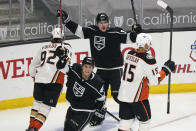 Los Angeles Kings right wing Carl Grundstrom, top center, celebrates after scoring against the Anaheim Ducks during the first period of an NHL hockey game Tuesday, April 20, 2021, in Los Angeles. (AP Photo/Marcio Jose Sanchez)
