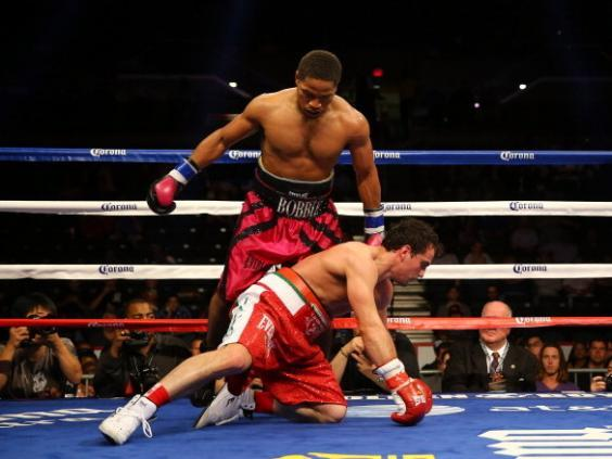 Shawn Porter knocks down Phil Lo Greco in their 2013 bout (Getty)