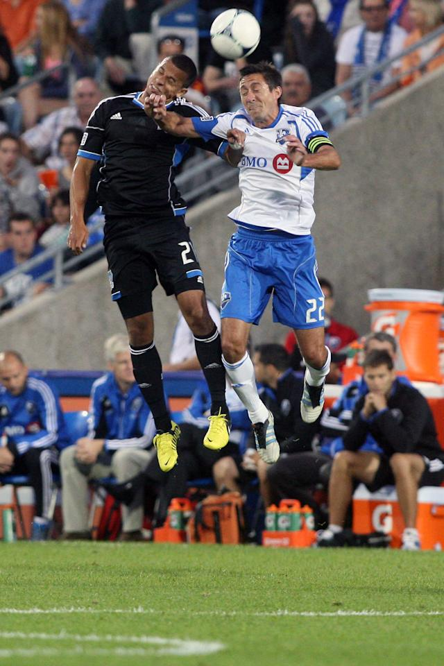 MONTREAL, CANADA - AUGUST 18:  Jason Hernandez #21 of the San Jose Earthquakes and Davy Arnaud #22 of the Montreal Impact jump to head the ball during the match at the Saputo Stadium on August 18, 2012 in Montreal, Quebec, Canada.  (Photo by Richard Wolowicz/Getty Images)