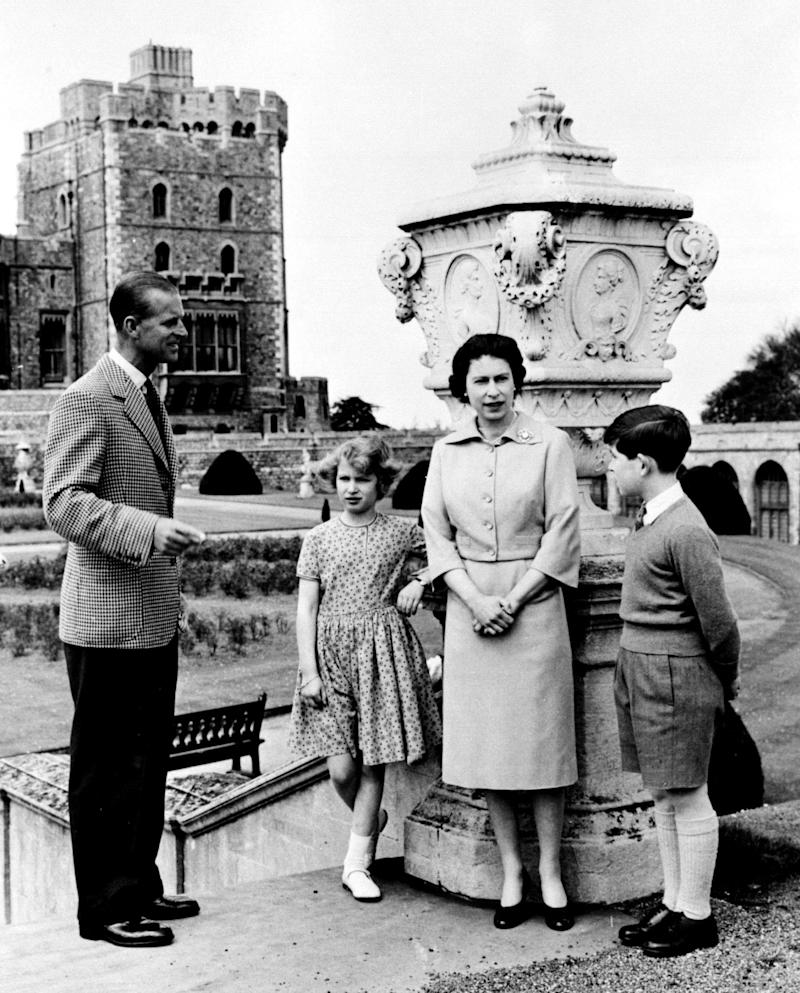 Queen Elizabeth II and Duke of Edinburgh with their children, Prince Charles, Prince of Wales and Princess Anne, the Princess Royal,at the top of the East Terrace Garden Steps at Windsor Castle, Berkshire. (Photo by PA Images via Getty Images)