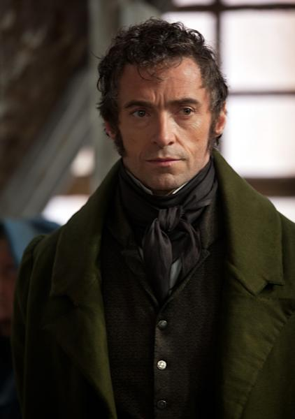"""FILE - This publicity image released by Universal Pictures shows Hugh Jackman as Jean Valjean in a scene from """"Les Miserables."""" The film is nominated for an Academy Award in the Makeup and Hairstyling category. The 85th Academy Awards air live on ABC on Sunday, Feb. 24, 2013. (AP Photo/Universal Pictures, Laurie Sparham, File)"""