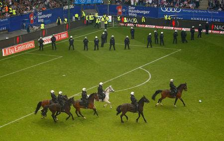 Soccer Football - Bundesliga - Hamburger SV v Borussia Moenchengladbach - Volksparkstadion, Hamburg, Germany - May 12, 2018 General view of mounted police and riot police on the pitch at the end of the match REUTERS/Morris Mac Matzen