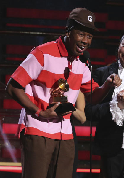 """Tyler, The Creator accepts the award for best rap album for """"Igor"""" at the 62nd annual Grammy Awards on Sunday, Jan. 26, 2020, in Los Angeles. (Photo by Matt Sayles/Invision/AP)"""
