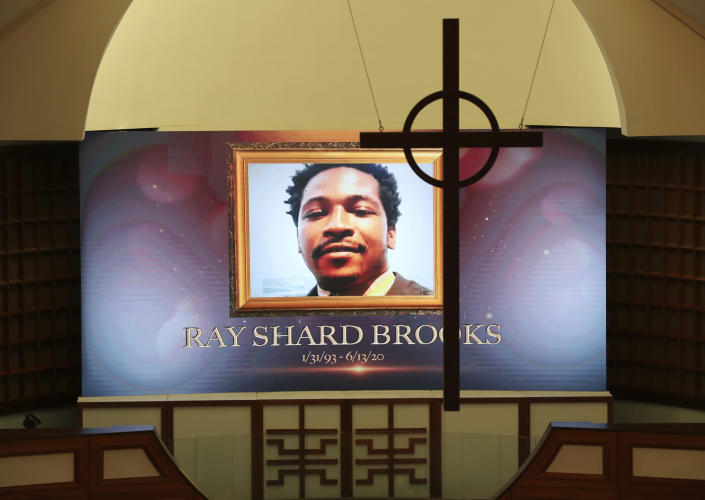 A cross hangs from the cathedral ceiling while Rayshard Brooks is memorialized on a screen during his public viewing at Ebenezer Baptist Church on Monday, Jun 22, 2020, in Atlanta. Brooks died June 12 after being shot by an officer in a Wendy's parking lot. Brooks' death sparked protests in Atlanta and around the country. A private funeral for Brooks will be held Tuesday at the church. (Curtis Compton/Atlanta Journal-Constitution via AP, Pool)