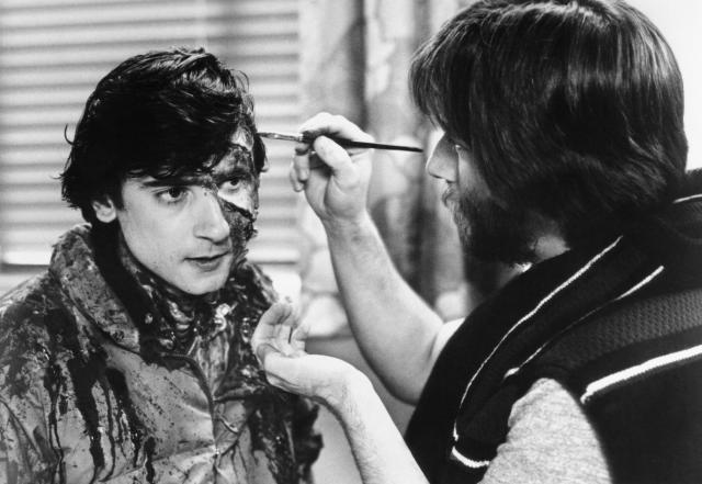 Rick Baker, right, applies makeup to Griffin Dunne for <i>An American Werewolf in London</i>, 1981. (Universal/courtesy Everett Collection)