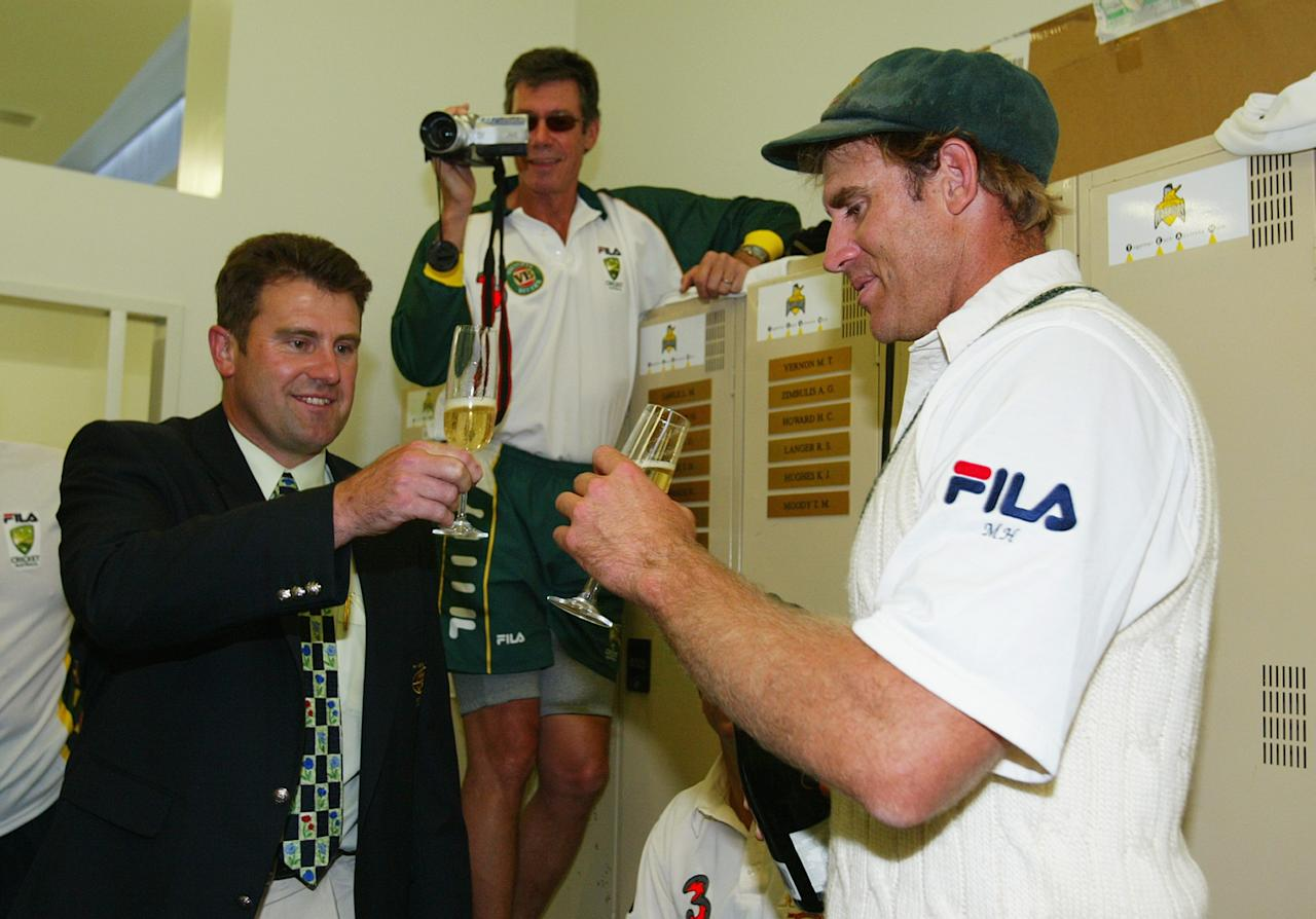 PERTH, AUSTRALIA - OCTOBER 10:  Matthew Hayden of Australia is congratulated by former Australian player Mark Taylor who held the previous Australian record score of 334 after Hayden scored 380 to break Brian Lara of The West Indies world record of 375 during day two of the First Test between Australia and Zimbabwe played at the WACA Ground on October 10, 2003 in Perth, Australia. (Photo by Hamish Blair/Getty Images)