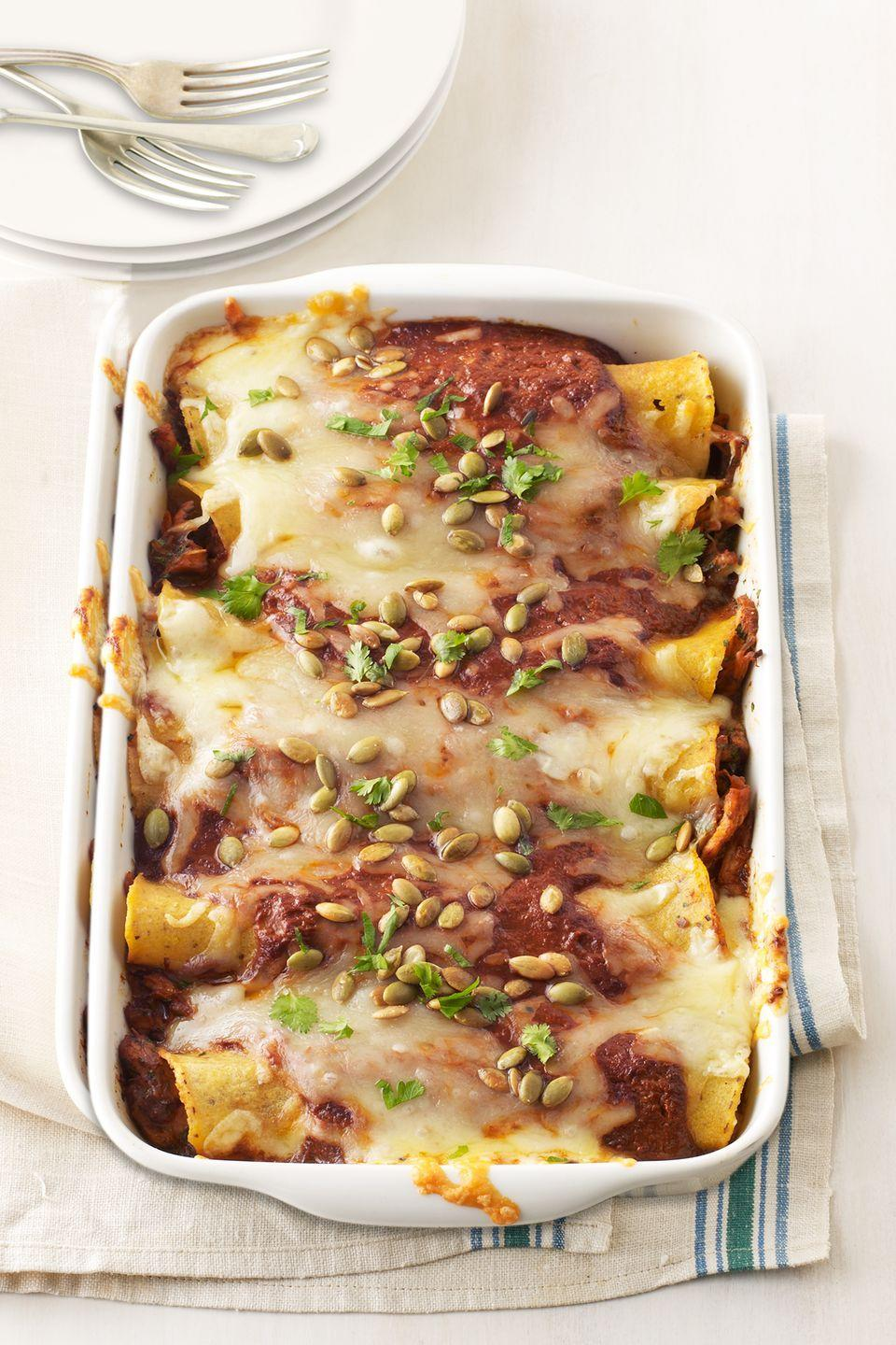 """<p>Pumpkin seeds, cilantro, and spicy chiles give your extra turkey new life and flavor.</p><p><strong><a href=""""https://www.countryliving.com/food-drinks/recipes/a33408/turkey-enchiladas-recipe-wdy1112/"""" rel=""""nofollow noopener"""" target=""""_blank"""" data-ylk=""""slk:Get the recipe"""" class=""""link rapid-noclick-resp"""">Get the recipe</a>.</strong></p><p><strong><a class=""""link rapid-noclick-resp"""" href=""""https://www.amazon.com/charola-rectangular-cl%C3%A1sica-grande-blanco/dp/B00WRIIREY/?tag=syn-yahoo-20&ascsubtag=%5Bartid%7C10050.g.1064%5Bsrc%7Cyahoo-us"""" rel=""""nofollow noopener"""" target=""""_blank"""" data-ylk=""""slk:SHOP BAKING DISHES"""">SHOP BAKING DISHES</a></strong></p>"""