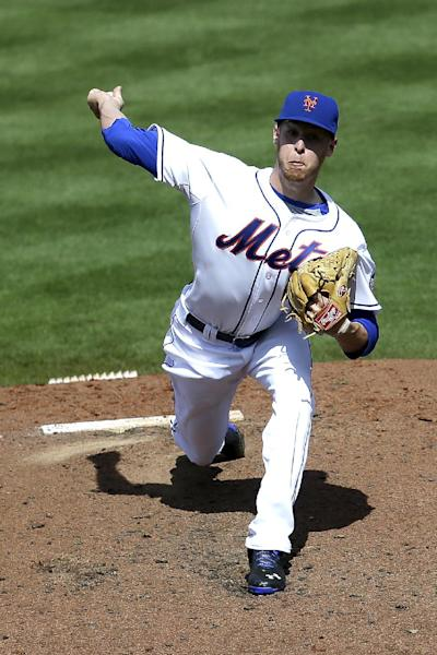 New York Mets pitcher Zack Wheeler throws a pitch during the fourth inning of an exhibition spring training baseball game against the Washington Nationals in Port St. Lucie, Fla., Saturday, Feb. 23, 2013. (AP Photo/Julio Cortez)